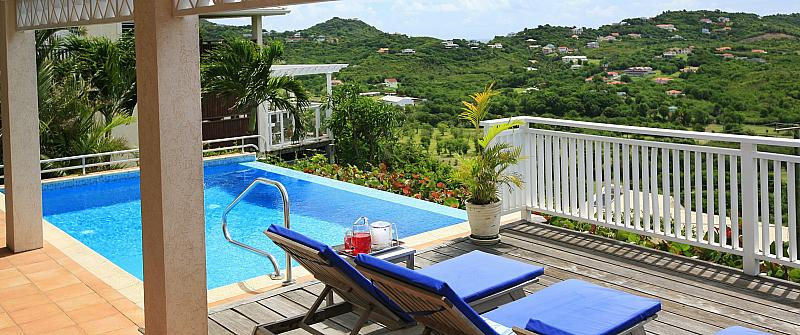 Aurora is an elegant6 bedroom luxury villa in Sandy Lane Barbados, set amongst 2 acres of sloping landscaped gardens with manicured lawns, numerous orchids and tropical flowers. This georgian style luxury villa for rent holds an elevated position allowing guests to enjoy panoramic views over the Sandy Lane Estate and the Caribbean sea beyond. The interior lay out is open and very spacious, typical of a Caribbean home, comfortable living room with pickled pine ceilings and georgian- style...